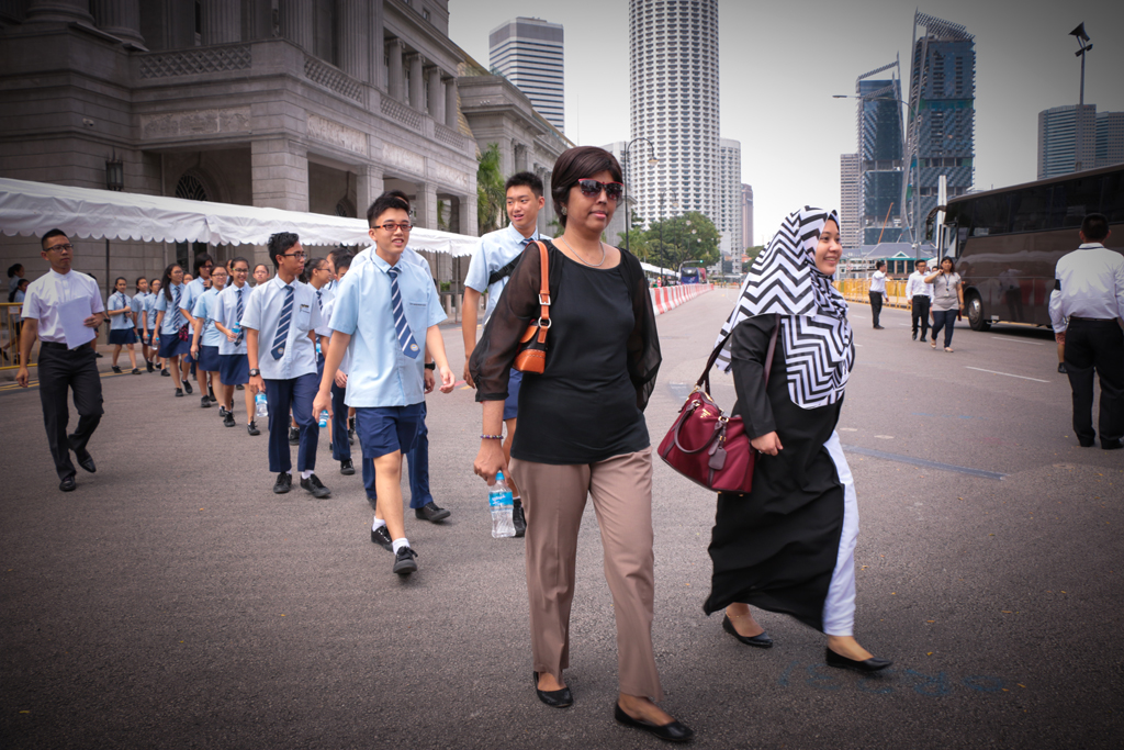 ONE HEART: Teachers and student council representatives from East View Secondary School make their way to the Parliament House. (Photo: Azmi Athni)