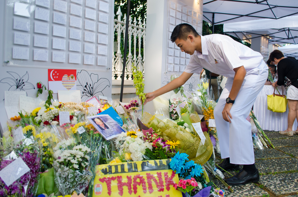 """For Darius Oon, 16, student at St Andrews Secondary, it was """"greatly depressing"""" for him to  accept Mr Lee's passing. Other than the bunch of flowers, he is  quick to tell of Mr Lee achievements to teach the next generation  of their founding father. """"I will tell them (next generation) that  the reason they are here, is because of Mr Lee Kuan Yew,"""" said"""