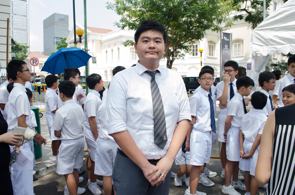 Mr Alvin Lee Chia Wei, 29,  a teacher at Maris Stella High brought students to pay tribute to the late Mr Lee Kuan Yew. The intention of bringing the students to the Parliament House was to educate the young students on Mr Lee Kuan Yew's contribution to the country. Mr Lee hopes that that the next generation of Singaporeans learn from Mr Lee Kuan Yew's resilience, to carry on his legacy. Maris Stella High had already given a speech to its students about Mr Lee Kuan Yew, there were pictures and slides to accompany the session.  (Photo: Marcus Tan)