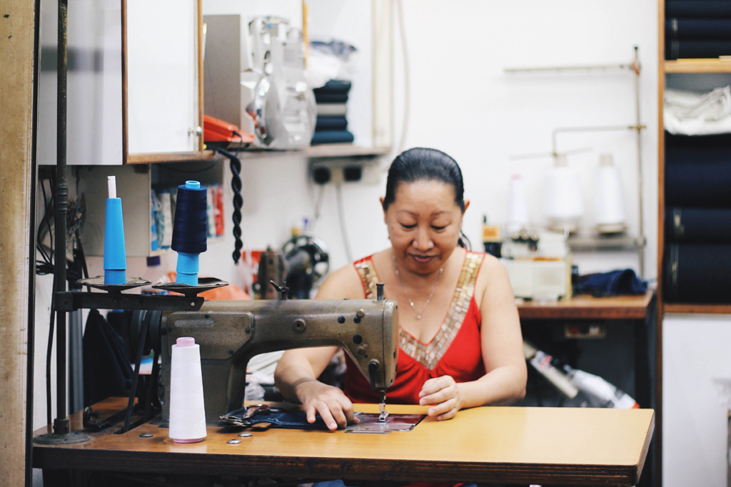 Stitching Up The Memories: With over 3 decades of experience, Ms Chong is an expert in the tailoring industry. The only disappointment her loyal customers will face is if she decides not to relocate when the building is due to close. (Photo: Sabrina  Muhleseddin)