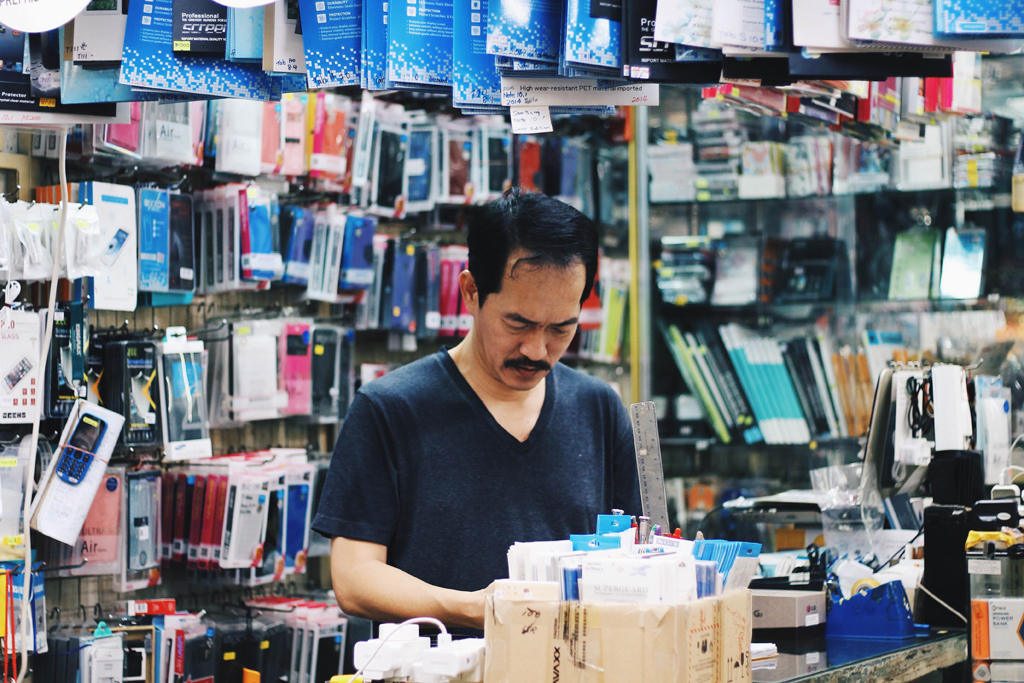 Phoney Business: Ah B, owner of Sim Guan electrical shop has sold everything from washing machines to phones in his 34 years of business, which makes leaving the premises all the more harder for him.(Photo: Sabrina Muhleseddin)