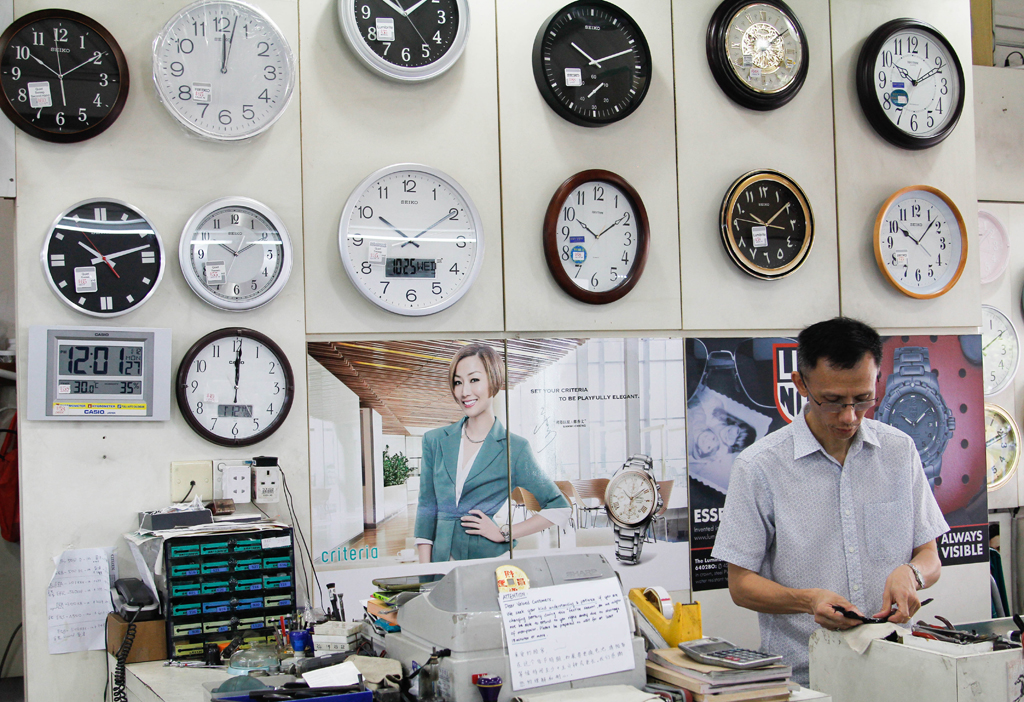 """Test of Time: For 32 years, See Toi Watches have been serving the community. Its owner, who is known as """"Da Jie"""" says she will miss the place once it closes and it will be hard to adapt to a new place. (Photo: Ken Lu)"""