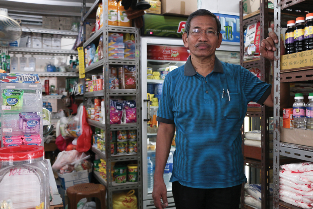 VANISHING TRADE: Mr Aruldas in his 'mama shop'. 'Mama shops' like this are a rare sight in contemporary Singapore, with modern convenience stores taking over its popularity in recent years. Photo: Azmi Athni