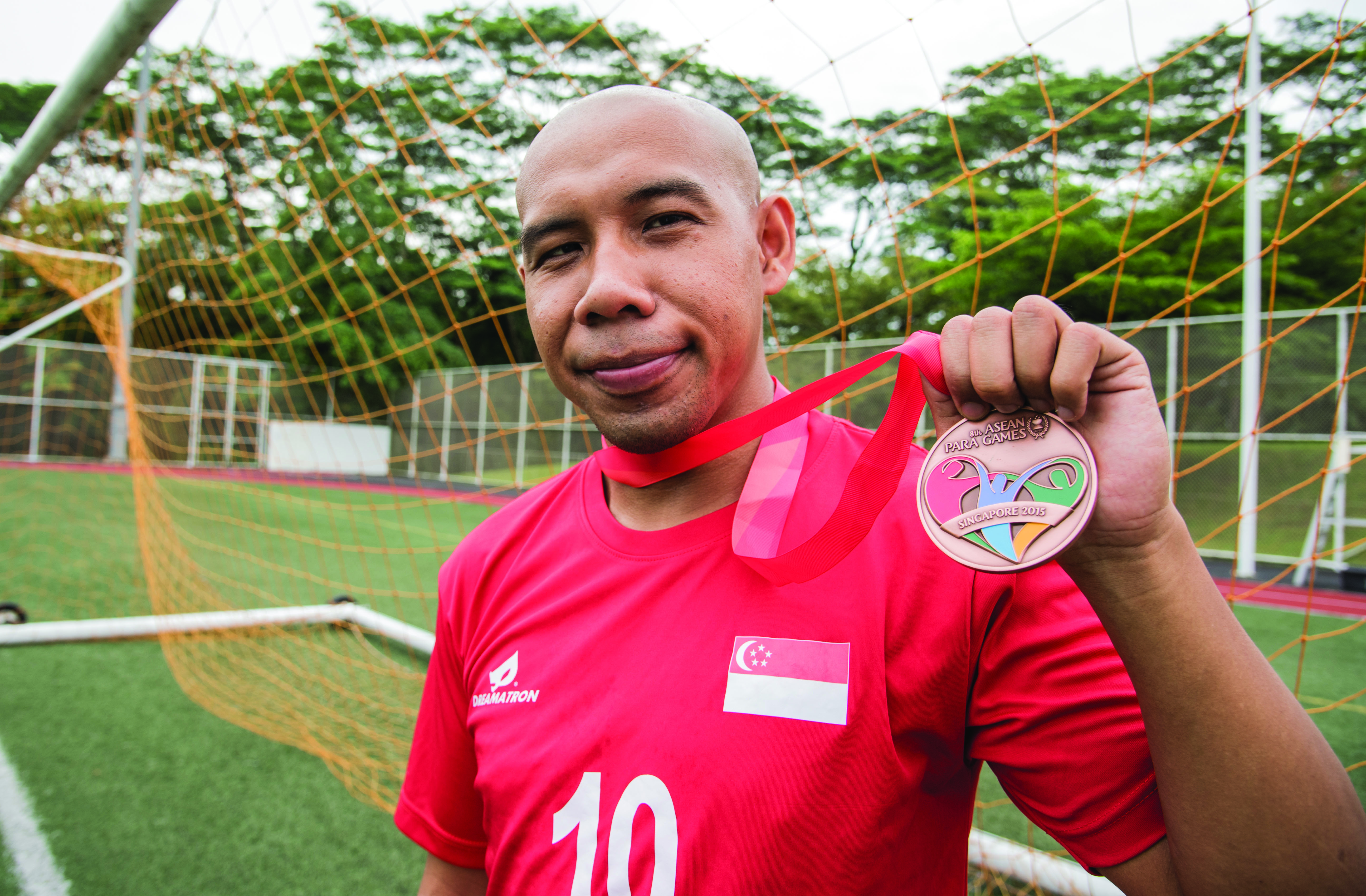 INTO THE HISTORY BOOKS: Being the first Singaporean to score a hat-trick at the new National Stadium, Khairul Anwar, 29, has overcome disability to become a cult hero in local football. PHOTO: Ken Lu