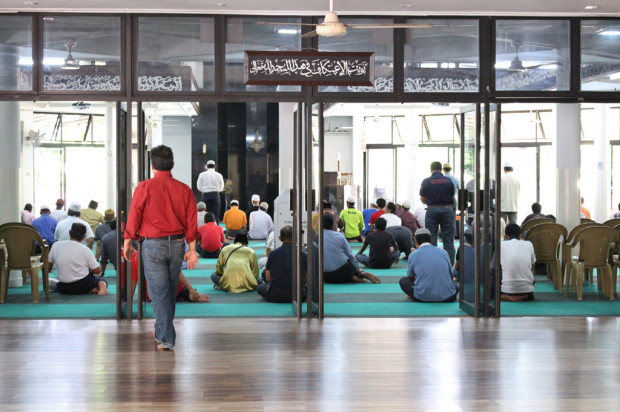 AN APPORTIONED PRAYER: The mosque provides separate prayer areas for both genders. Men are given the ground floor while women partake in their prayers a level above. (Photo: Emmanuel Phua)