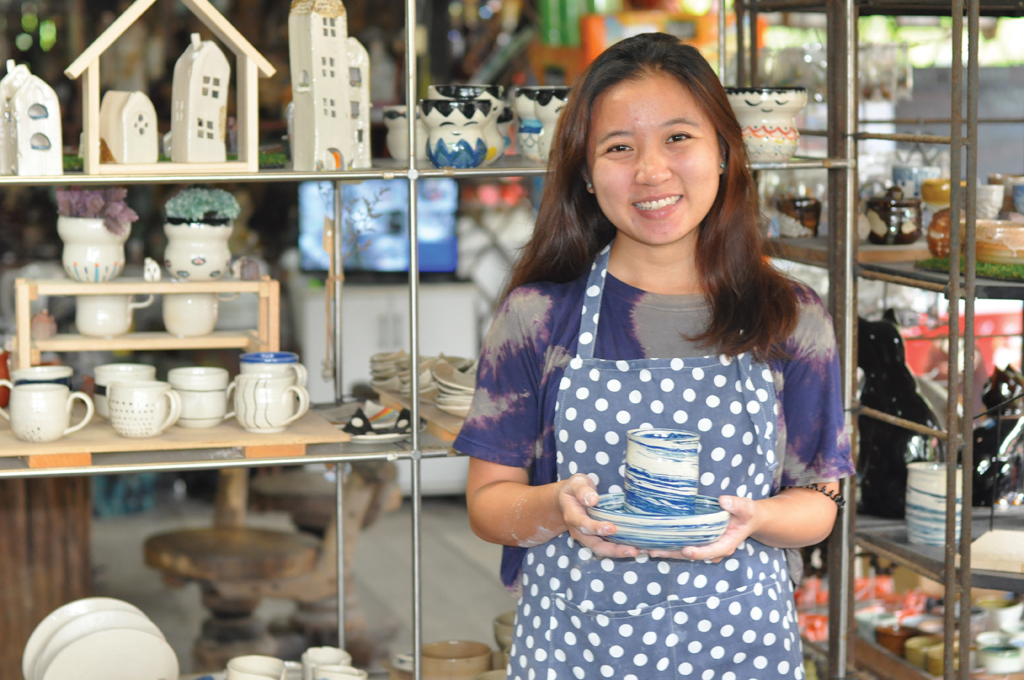 ART WITH A HEART: When her dog died, Miss Stella Tan found solace in pottery and crafted the sky-blue cup and saucer as she believed her dog went to Heaven in the skies. (Photo: Karl Lim)