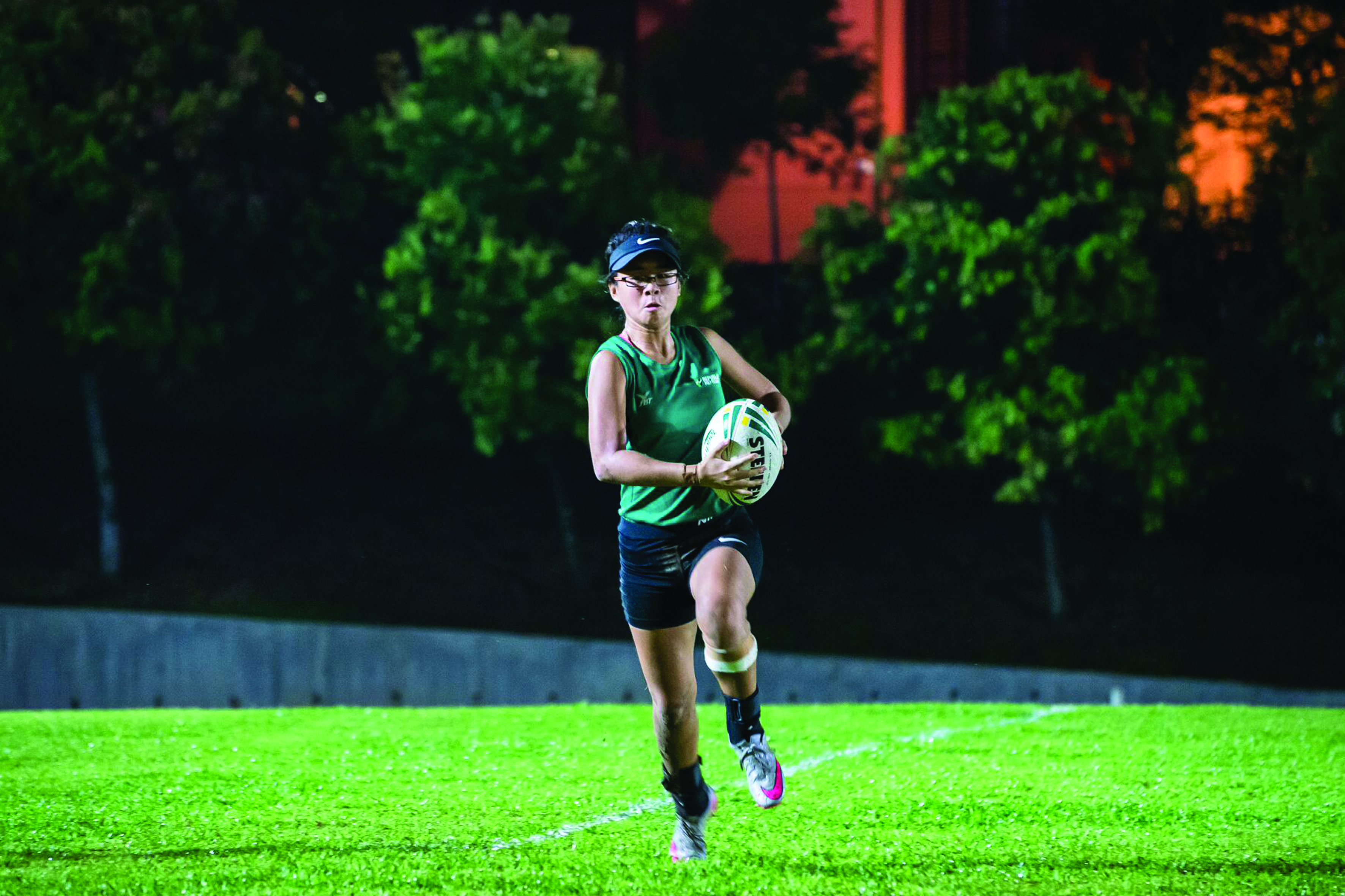 ON THE BALL: Touch Rugby player Tessa Amanda Sa'at, 19, spends six days a week preparing for the Polytechnic- Institute of Technical Education (POL-ITE) Games. Tessa feels a player needs humility, passion and determination to be a top sportsman. PHOTO: Zaini Qayyum